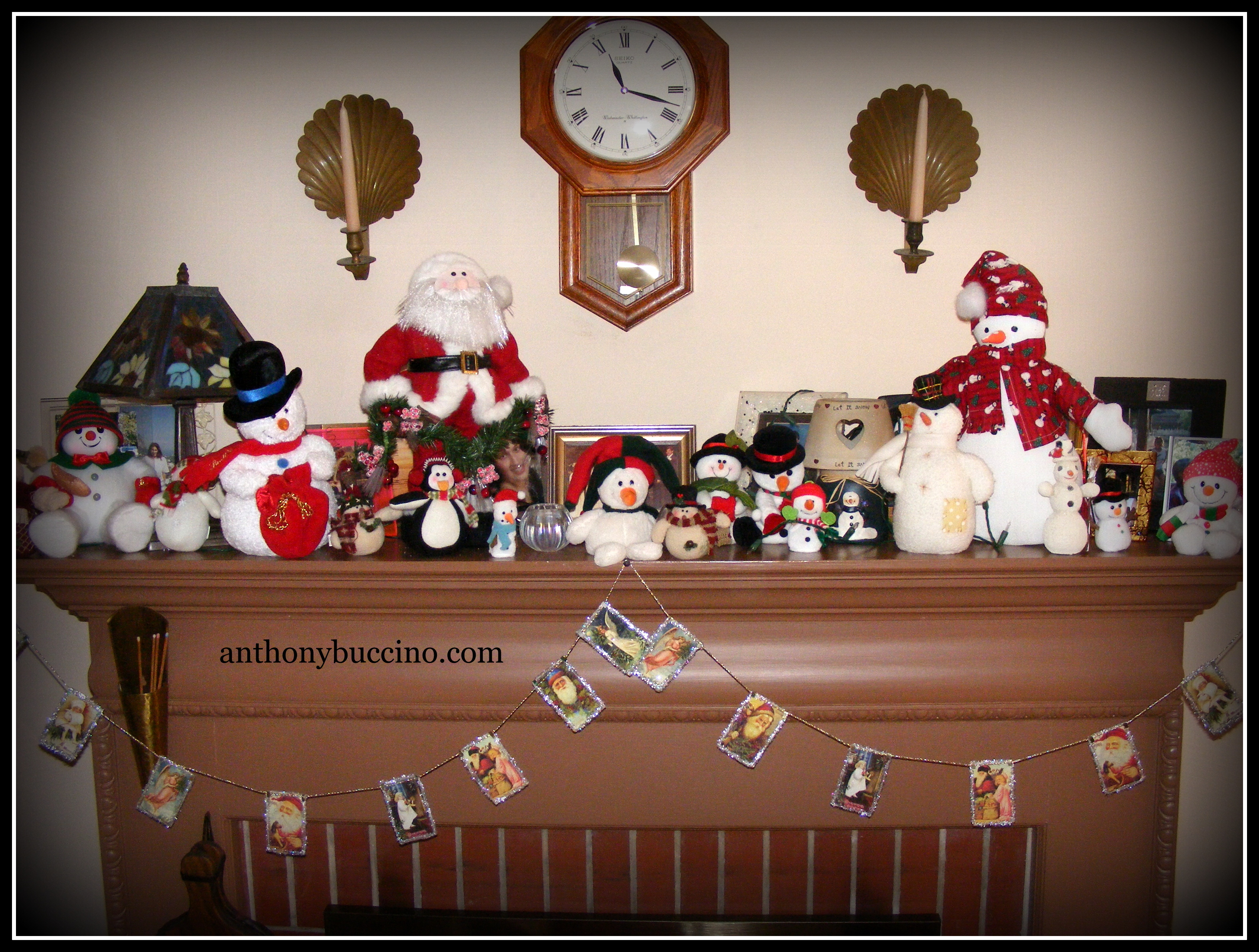 Snowmen on Fireplace Mantel by Anthony Buccino